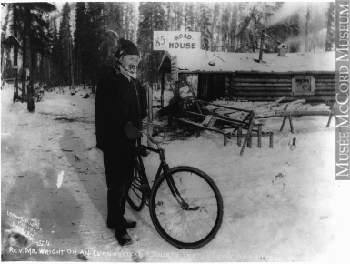 Photograph | Rev. Wright touring the Klondike on bicycle, at 85 Road House, Klondike, YT, about 1898 | MP-0000.2360.78